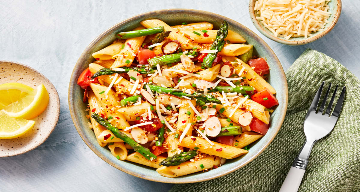 Penne Rustica with a Kick tossed with Asparagus and topped with Crispy Panko